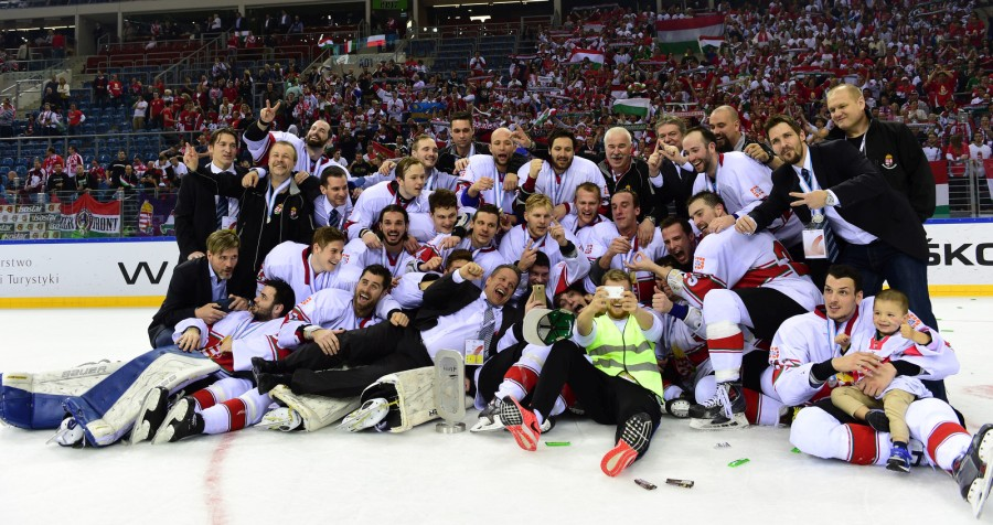 The Hungarian team poses for a team photo after reaching second place and promotion at the 2015 IIHF Ice Hockey World Championship Division I Group A. Photo: Miroslaw Ring
