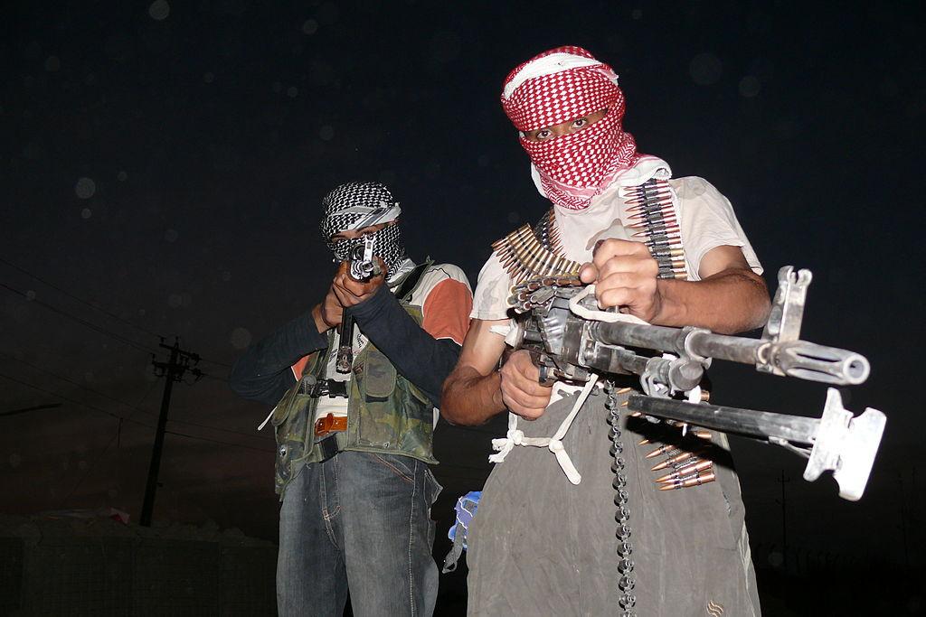 1024px-Iraqi_insurgents_with_guns
