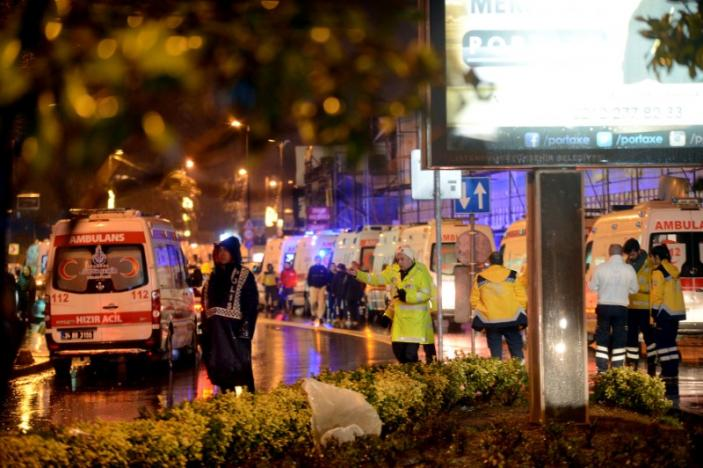 Ambulances line up on a road leading to a nightclub where a gun attack took place during a New Year party in Istanbul